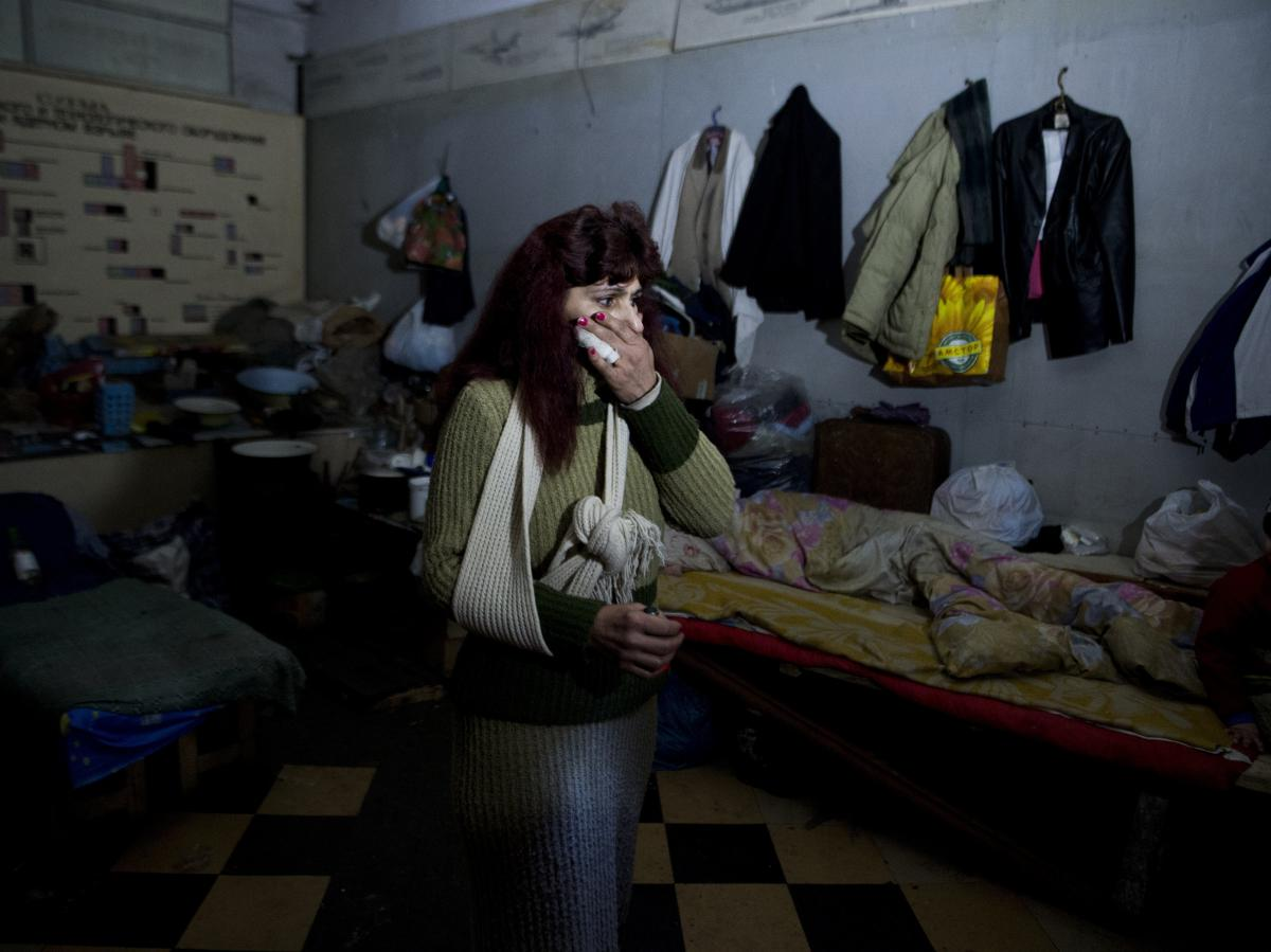 Tatjana stands March 6 in a Soviet-era bomb shelter near Donetsk's airport in eastern Ukraine. More than 200 people used the shelter at the height of the fighting between Ukrainian troops and pro-Russian separatist fighters. Many of those who fled the are