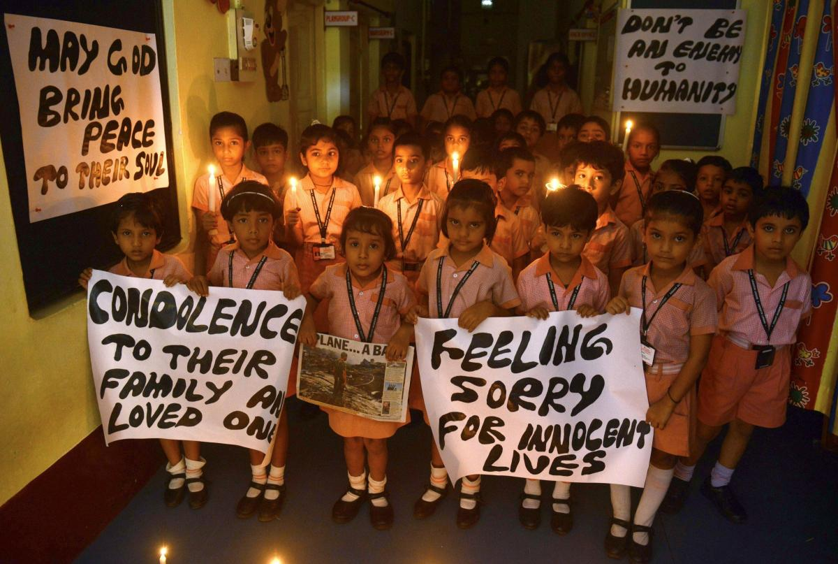 Indian schoolchildren hold candles and prayer messages for those killed in the crash of a Malaysia Airlines plane carrying 298 people from Amsterdam to Kuala Lumpur.