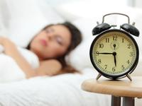 Sleeping with an alarm clock.