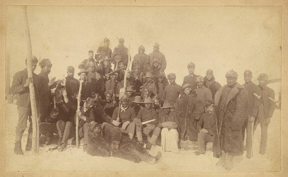 Soldiers of the 25th Infantry — some wearing buffalo robes — pose for a photo in Montana in the late 19th Century. Like the men of the 9th and 10th cavalry, these troops were referred to as Buffalo Soldiers.