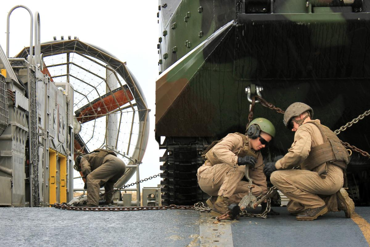 Cpl. Kathryn Bynum (center) works with a fellow Marine on an exercise focused on securing the AAVs.