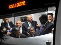 Japanese Prime Minster Shinzo Abe (right), Somalian President Hasan Sheikh Mahmud, Turkish President Abdullah Gul and Turkish Prime Minister Recep Tayyip Erdogan listen to an announcement in a train car at the Uskudar Marmaray station ahead of its inaugur