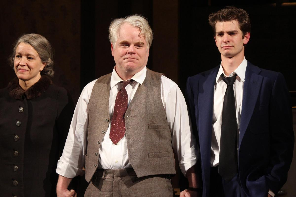 Linda Emond, Hoffman and Andrew Garfield take their opening night curtain call in Arthur Miller's Death of a Salesman at The Barrymore Theatre in New York City in 2012.
