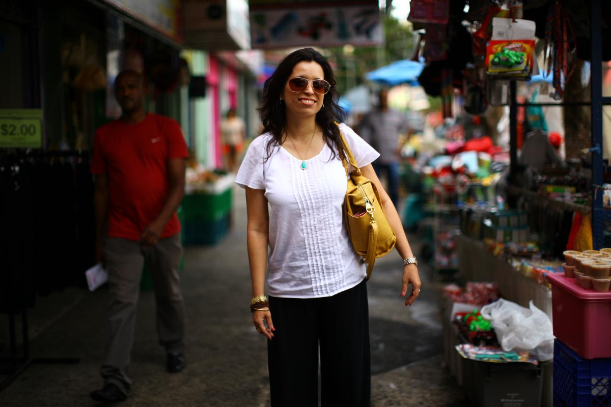 Rosario Rivera is an economist and professor at the University of Puerto Rico. She lives on the island with her husband, a lawyer, but they've considered moving to the mainland. She is seen here at a street market in the Rio Piedras neighborhood of San Ju