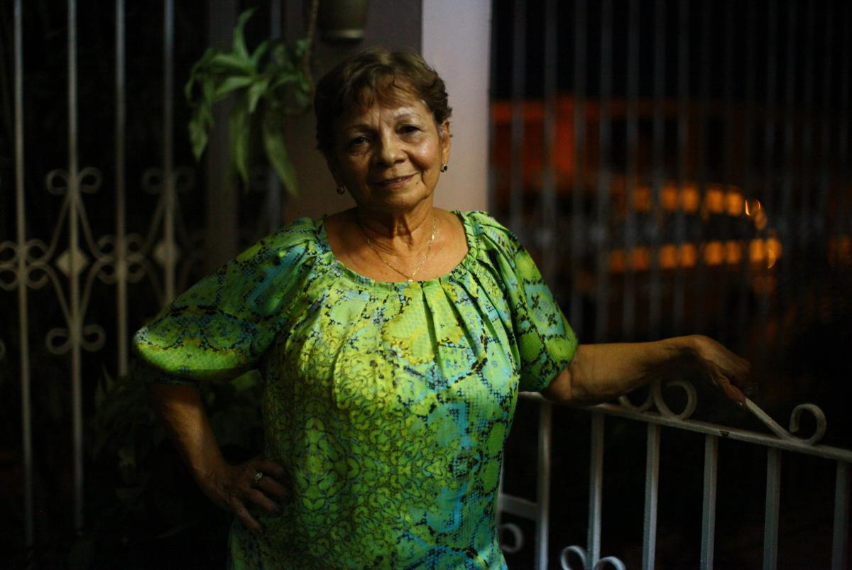 """Genoveva """"Veva"""" Camacho raised her family in Puerto Rico, and still lives in the town of Cabo Rojo with her grandson, Edward. Her daughters and granddaughter moved to Florida in search of a better life."""