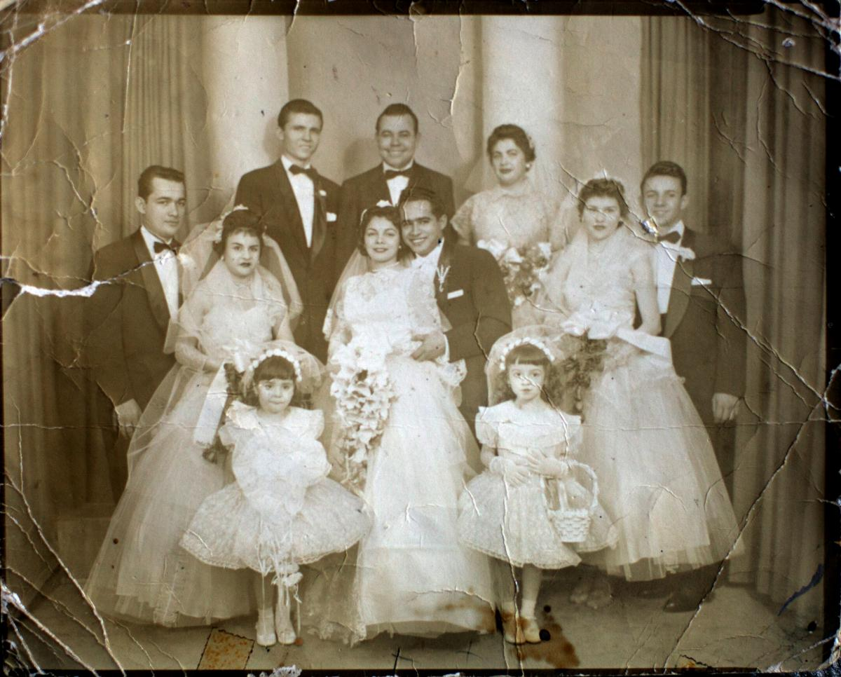 Camacho and Juan Bonet are seen on their wedding day. Her family has deep roots in Puerto Rico. She says she doesn't want to leave, but may eventually have to join her daughter in Central Florida.