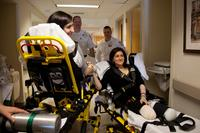 Celeste Corcoran (right) and her daughter Sydney Corcoran are transported to Spaulding Rehabilitation Hospital from Boston Medical Center on April 28. Sydney, who nearly bled to death after being struck by shrapnel in her thigh, is expected to recover mos