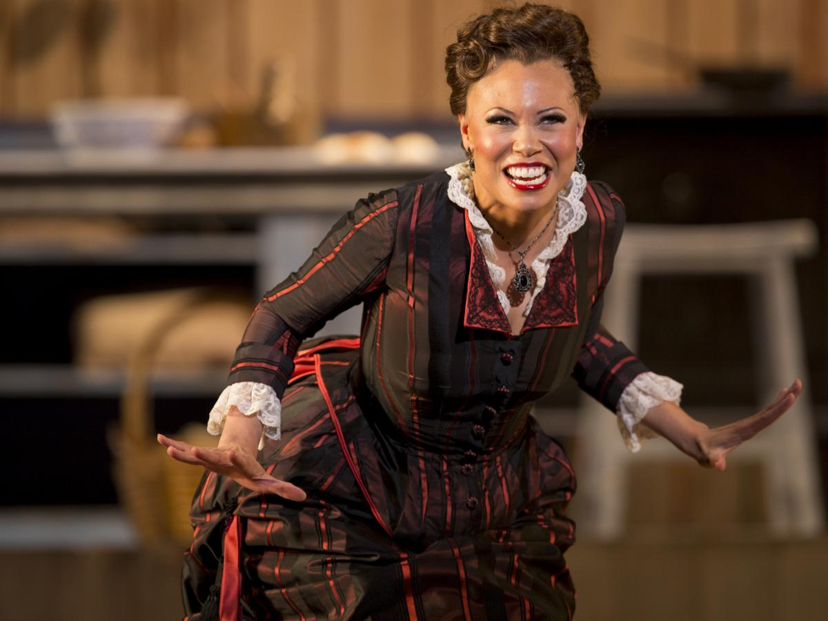 """When she's discovered to be a multiracial woman """"passing"""" as white, the Cotton Blossom's star performer, Julie (Alyson Cambridge), is forced to leave the company."""