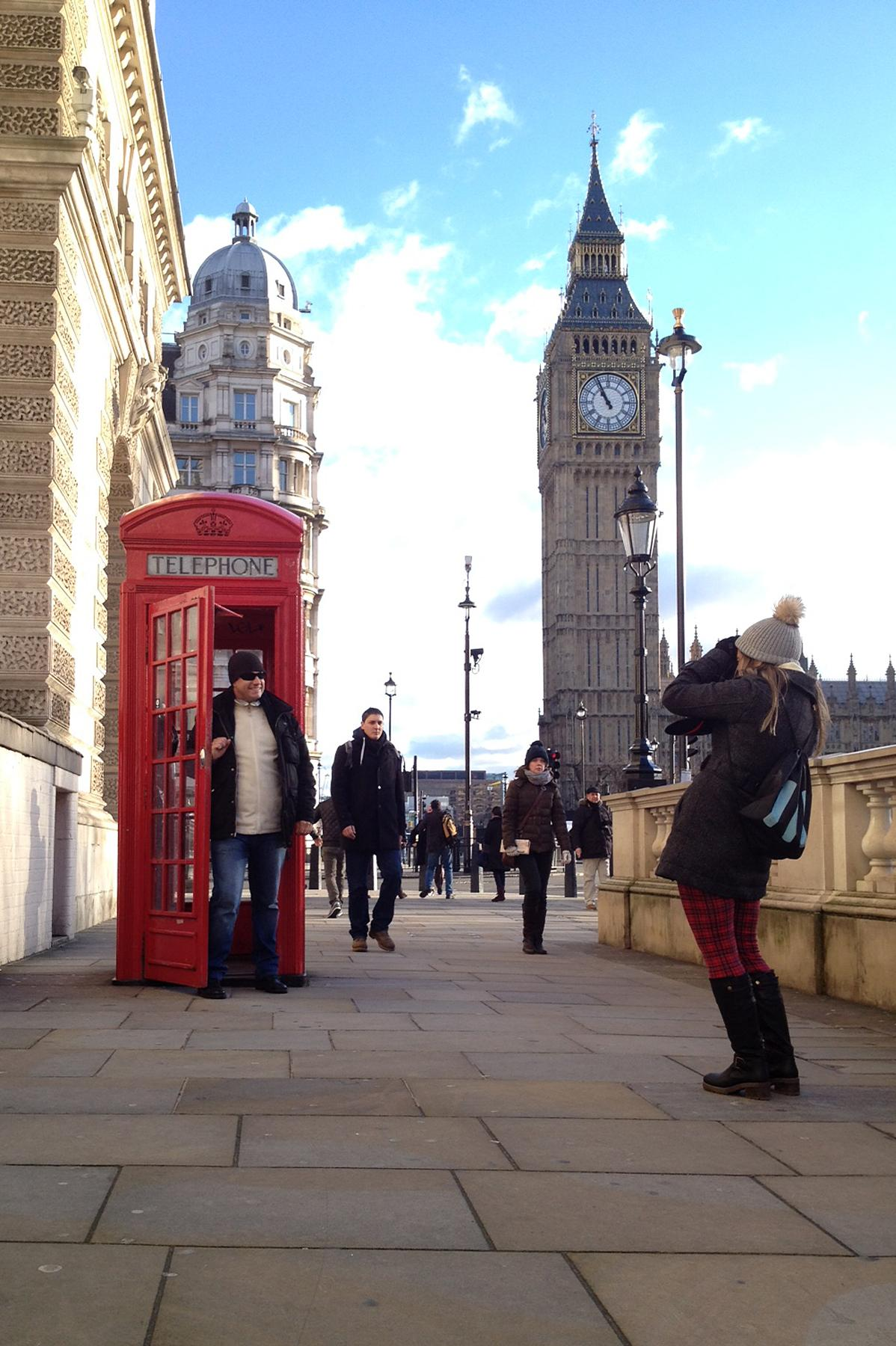 """The most photographed phone booth in London sits in front of Big Ben. The number of beloved crimson """"telephone boxes"""" in the United Kingdom has fallen sharply in recent years, from 92,000 in 2002 to just 48,000 now."""