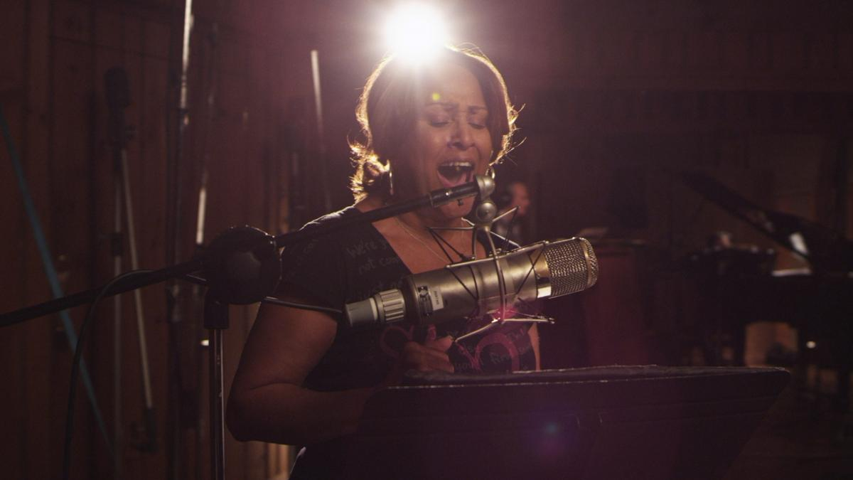 Darlene Love, one of the background singers featured in Twenty Feet From Stardom, didn't receive credit for singing hits in the 1950s and '60s and says her career was derailed by legendary producer Phil Spector.