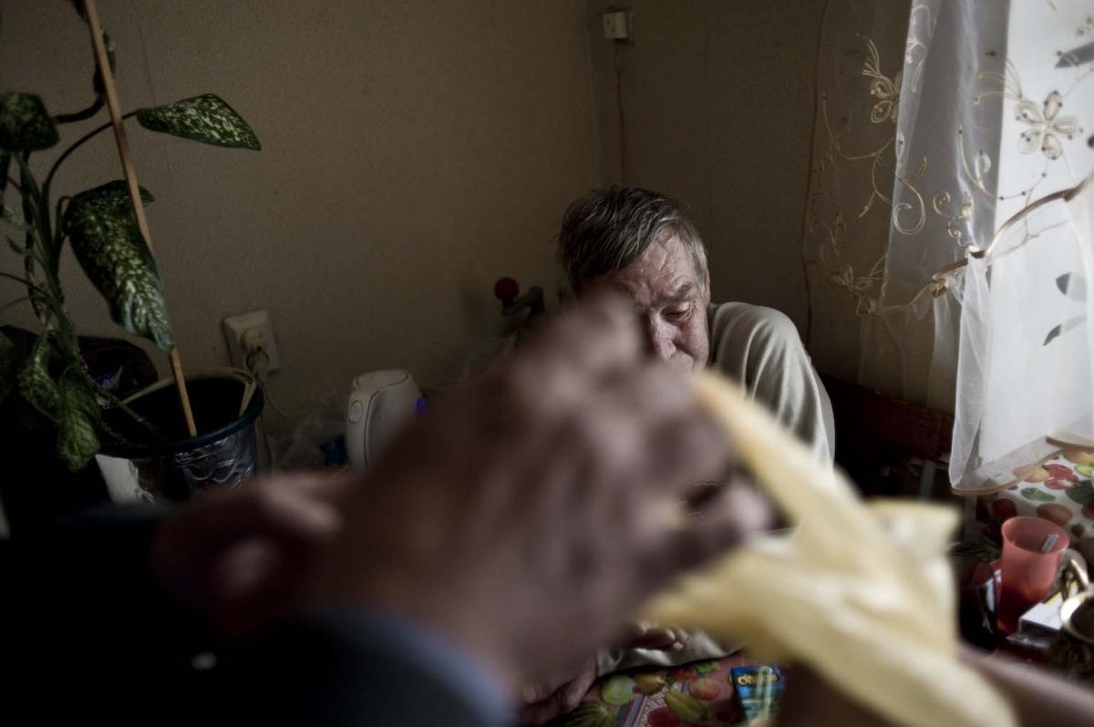 Sputnik nurses visit patients, such as Anatoliy Kharkov, twice each day to give them anti-TB medications.