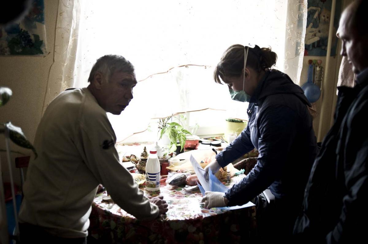 Safronova brings Kharkov food and anti-TB medications at his home in Tomsk.