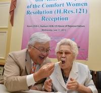 Rep. Mike Honda, D-Calif., and Ok-seon Lee, who says she was forced into sex slavery during World War II, celebrate the anniversary of a 2007 House resolution that asks the Japanese government to apologize to comfort women.