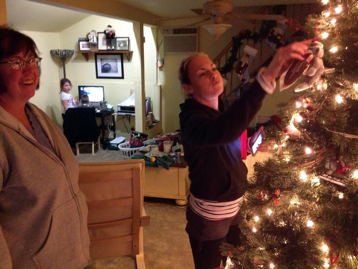After Sandy, the Hardys' goal was to get their house together enough to have a normal Christmas. The ornaments survived the storm. Shown here, from left, are Linda Hardy, her granddaughter Annie and her daughter Heather.