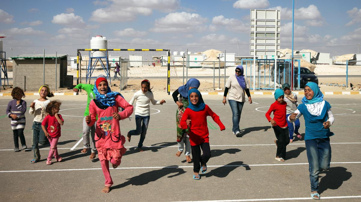 Children play at the Zaatari refugee camp in Jordan, where more than 120,000 Syrian refugees live. Roughly two-thirds are kids, many of whom have been traumatized by the violence in their homeland.