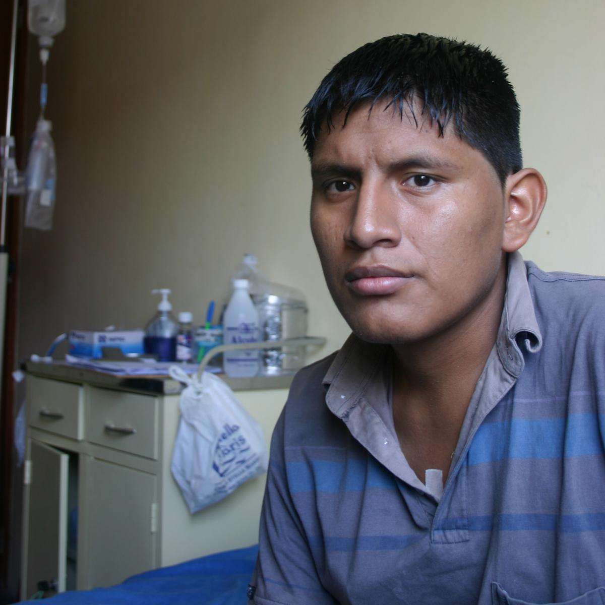 Luis Henry Robles Higinio, 19, has XDR-TB. His right lung was removed due to the extent of the disease, and he had a port implanted in his chest for his twice-daily drip of TB drugs. With the end of IV treatment just two weeks away, he's in a positive fra