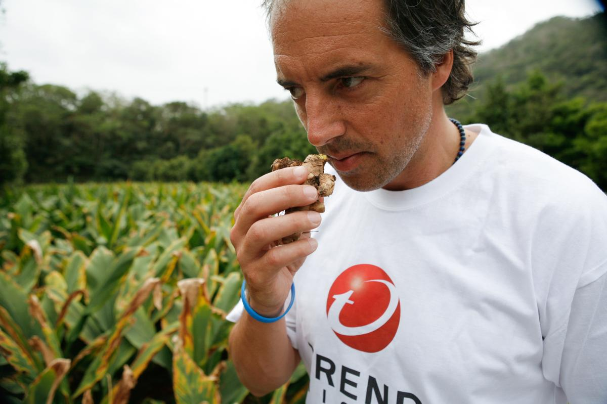 Blue Zones' Dan Buettner smells turmeric grown in Okinawa.