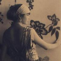 Woman, viewed from behind, between 1920 and 1930.