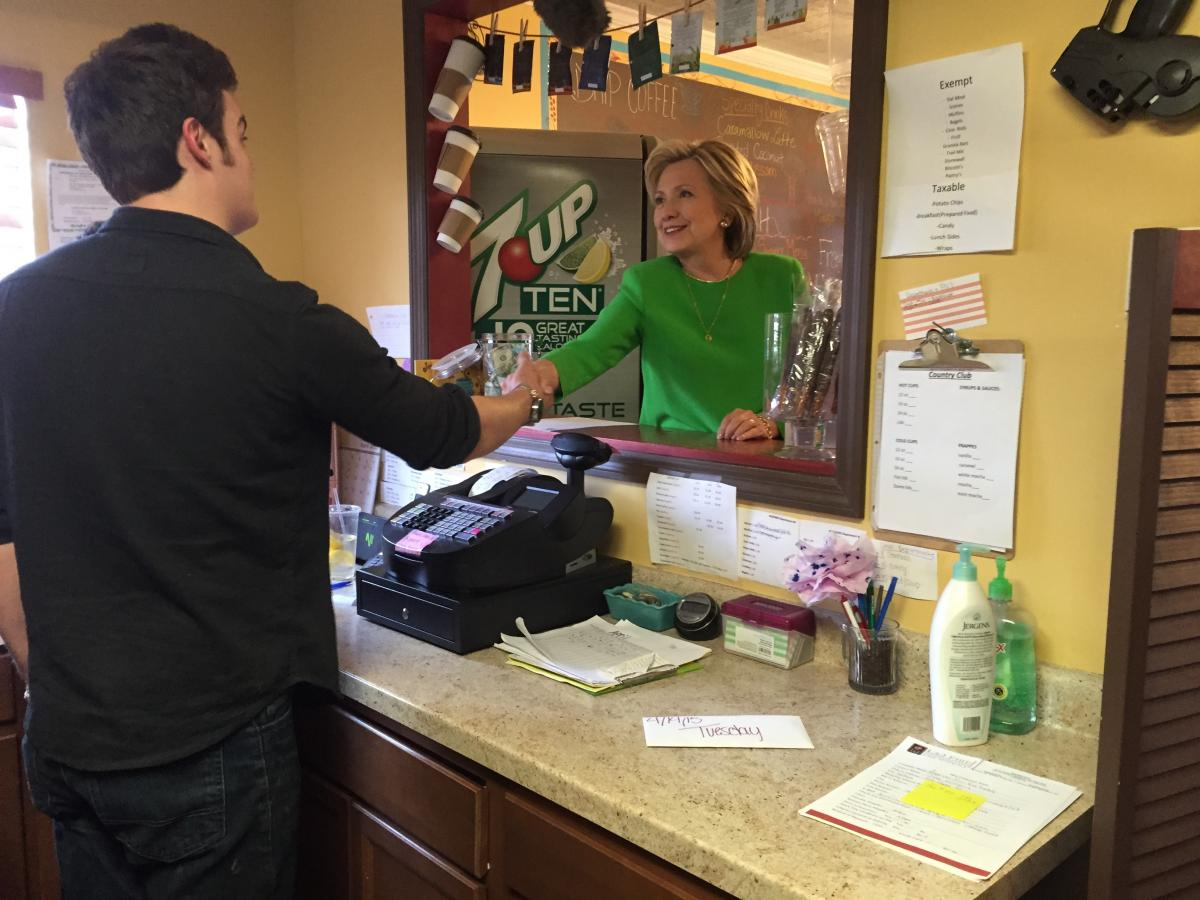 Hillary Clinton meets her barrista. She ordered a chai tea, a caramel latte and a water.