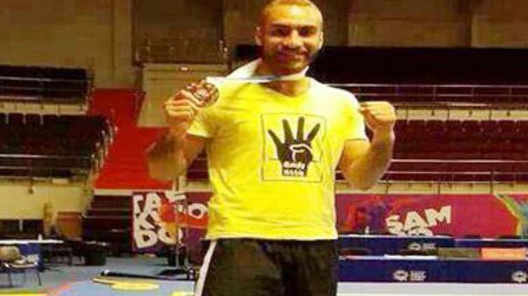 Egypt's Mohamed Yousef won a gold medal at the kung fu championships in Russia in October. He then put on a yellow T-shirt with a four-finger salute to express solidarity with protesters opposing Egypt's military-backed government. Egyptian sports officia
