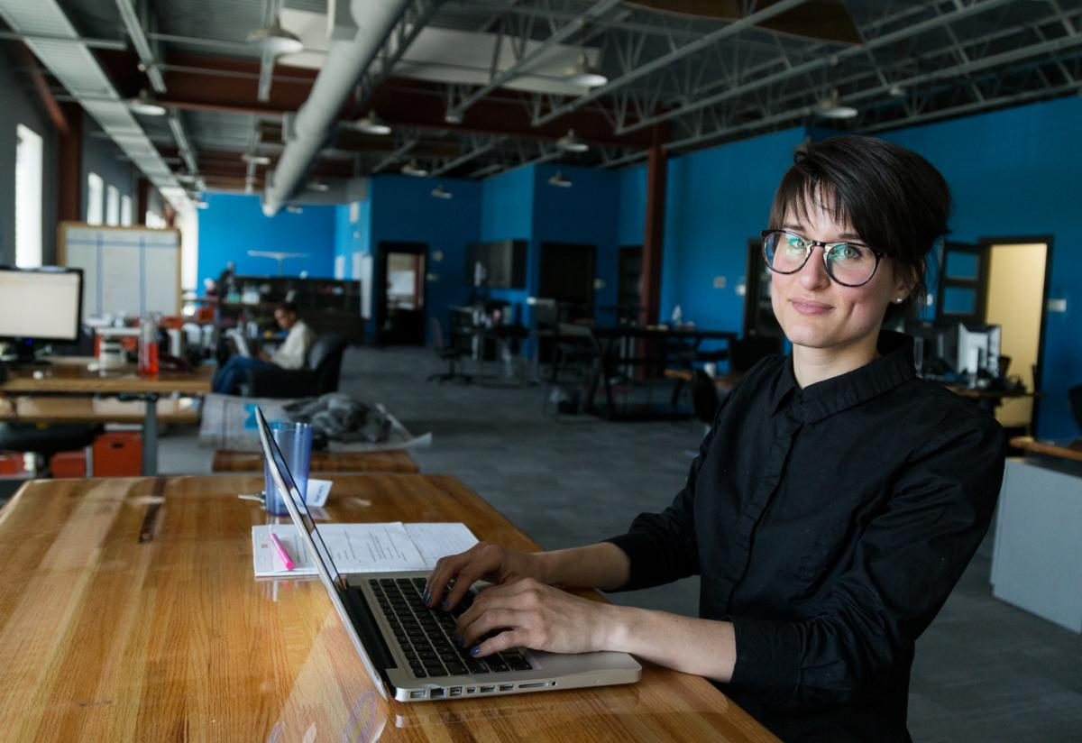 Blake Rupe, owner and founder of Re-APP, Inc. at work at Vault Coworking & Collaboration Space in Cedar Rapids, Iowa.