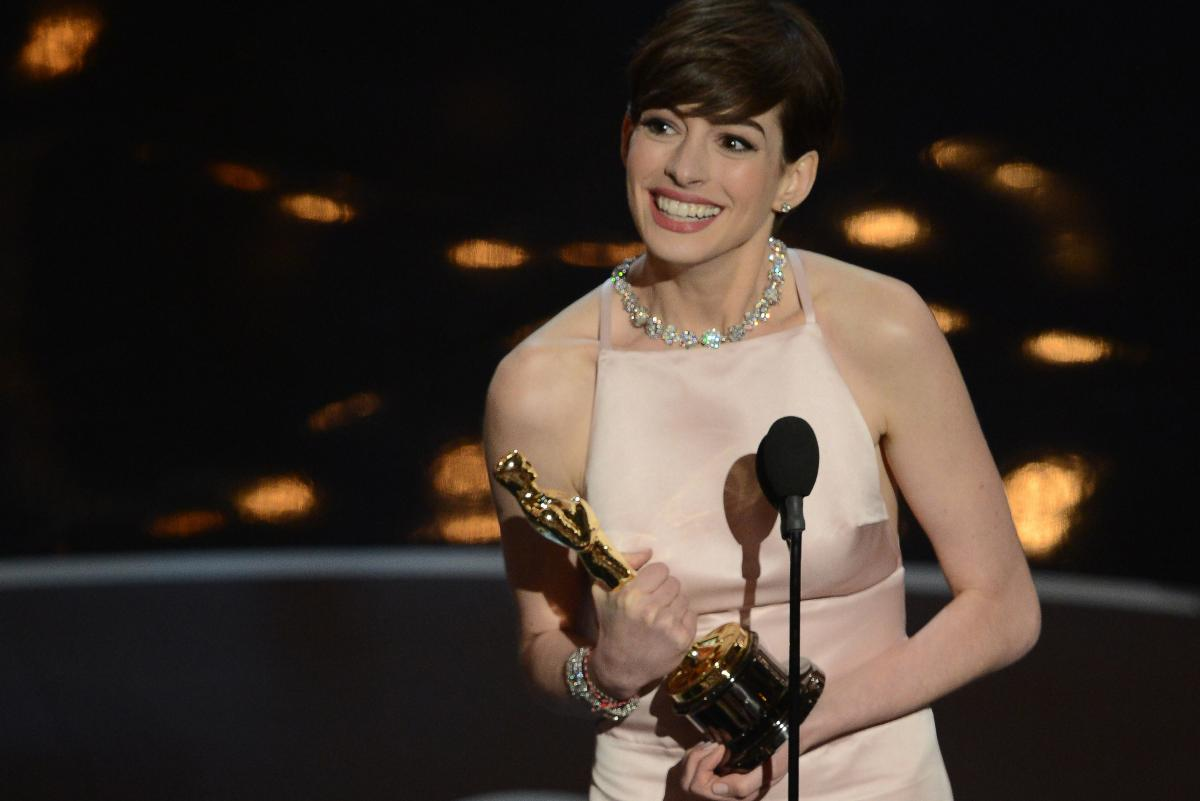 "Anne Hathaway accepts the Oscar for best supporting actress for her role in ""Les Miserables."""