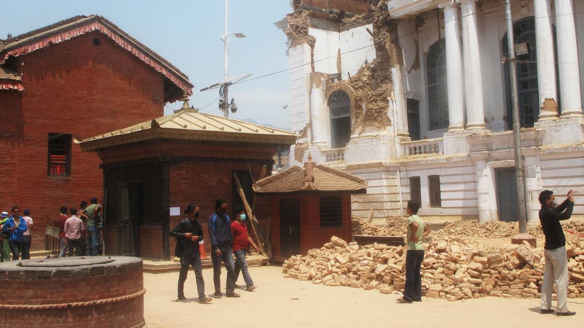 In last month's devastating earthquake, the Kumari's home (left) remained intact, suffering only minor cracks, while surrounding buildings in Kathmandu's historic Durbar Square were badly damaged or destroyed.