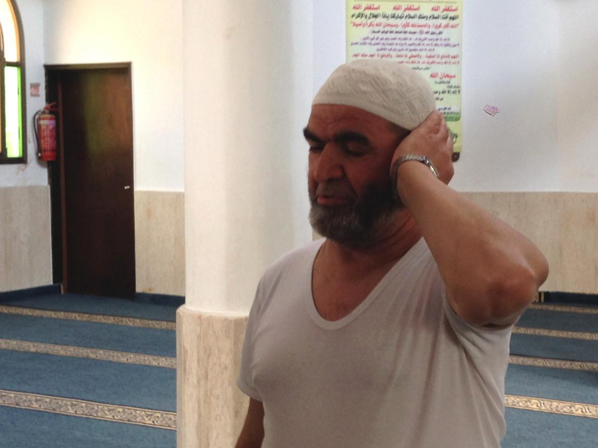 """""""When we go to Tel Aviv, or to the beach, we see people in different clothing, and nothing happens,"""" says Rashid Mansur, who recites the call to prayer five times a day at a Tira mosque."""