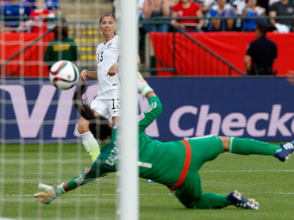 American forward Alex Morgan scores her first goal of this year's Women's World Cup on Monday against goalkeeper Stefany Castano of Colombia. The U.S. won the match 2-0.