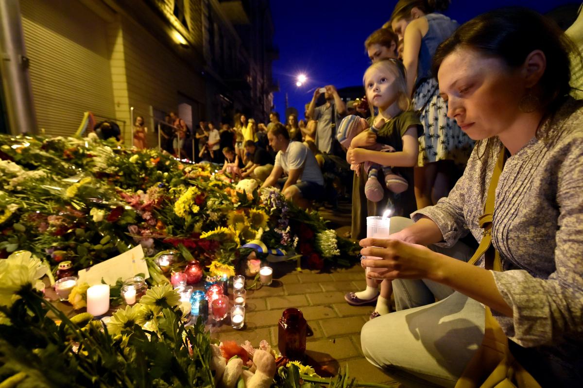 A woman lights a candle in front of the Netherlands Embassy in Kiev, Ukraine, to commemorate those aboard Flight MH17. The flight was on its way from Amsterdam to Kuala Lumpur when it crashed.