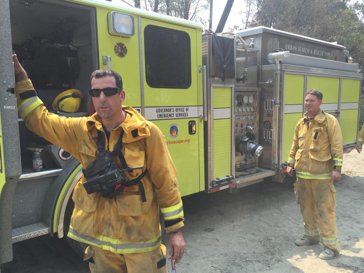 Firefighters with a California Office of Emergency Services strike team take a break from mopping up hot spots on the Rocky Fire. Career firefighters working the blaze say they've never before seen a wildfire burn with such intensity and extreme behavior.