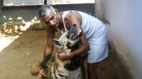 Prakash Amte, pictured with his dog, founded a clinic and a school in a remote jungle in the center of India.