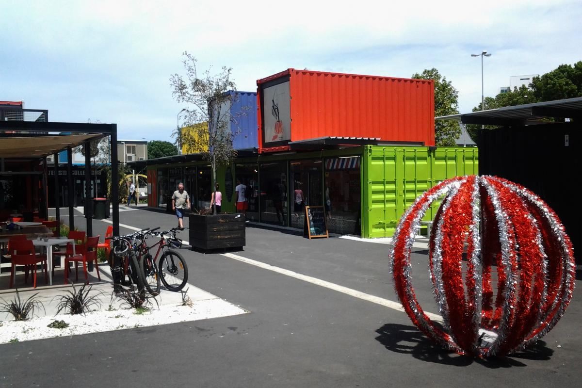 Pop-up stores and cafes in shipping containers cheer up the center of the earthquake-battered city.