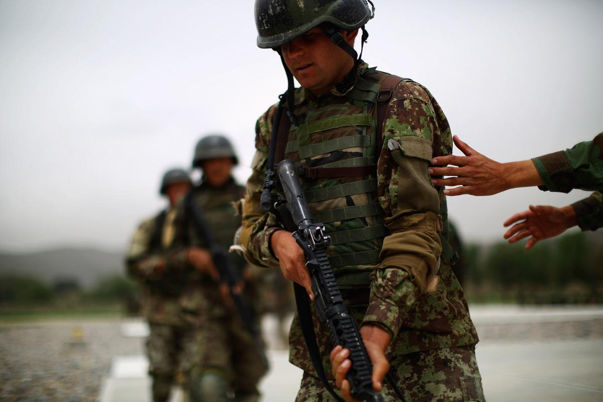 Commandos practice taking up a security position. With the U.S. combat role over in Afghanistan, the country's security now depends on people like the Afghan commandos.