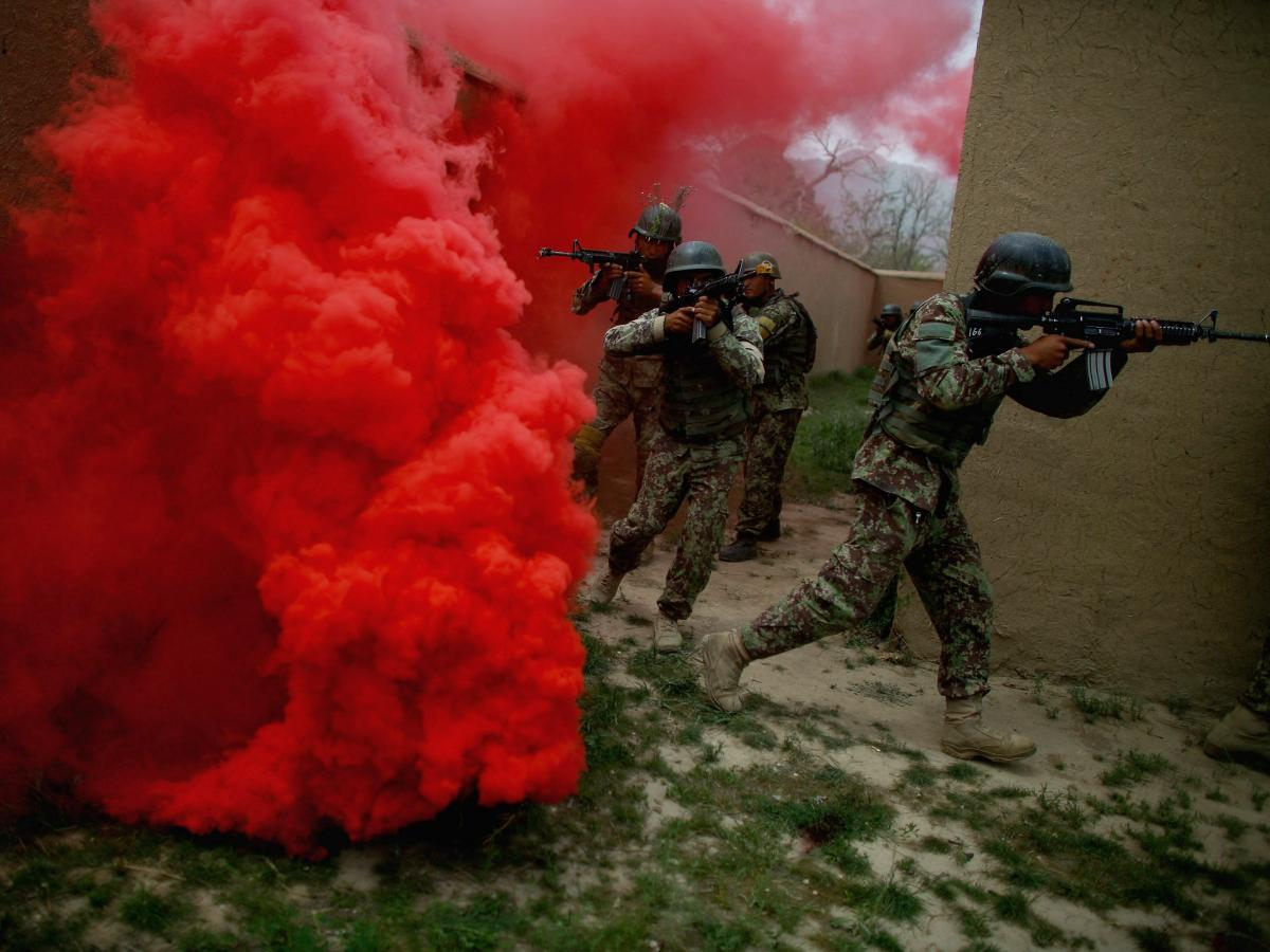 Afghan commandos move through a smokescreen during a training exercise at Camp Commando on the outskirts of Kabul, Afghanistan.