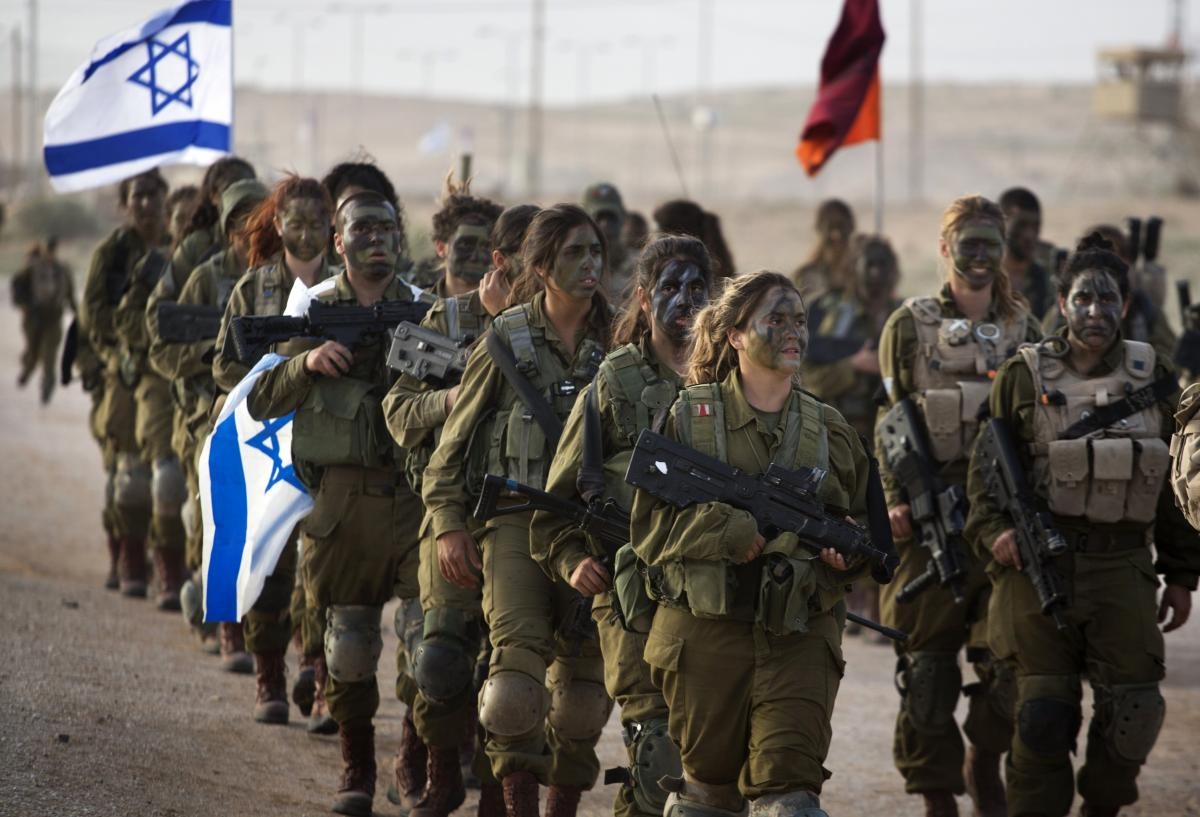 Soldiers of Israel's 33rd Caracal Battalion take part in a graduation march in the northern part of the southern Israeli Negev desert on March 13. The Caracal was formed in 2004 with the chief purpose of giving women a chance to serve in a true combat rol
