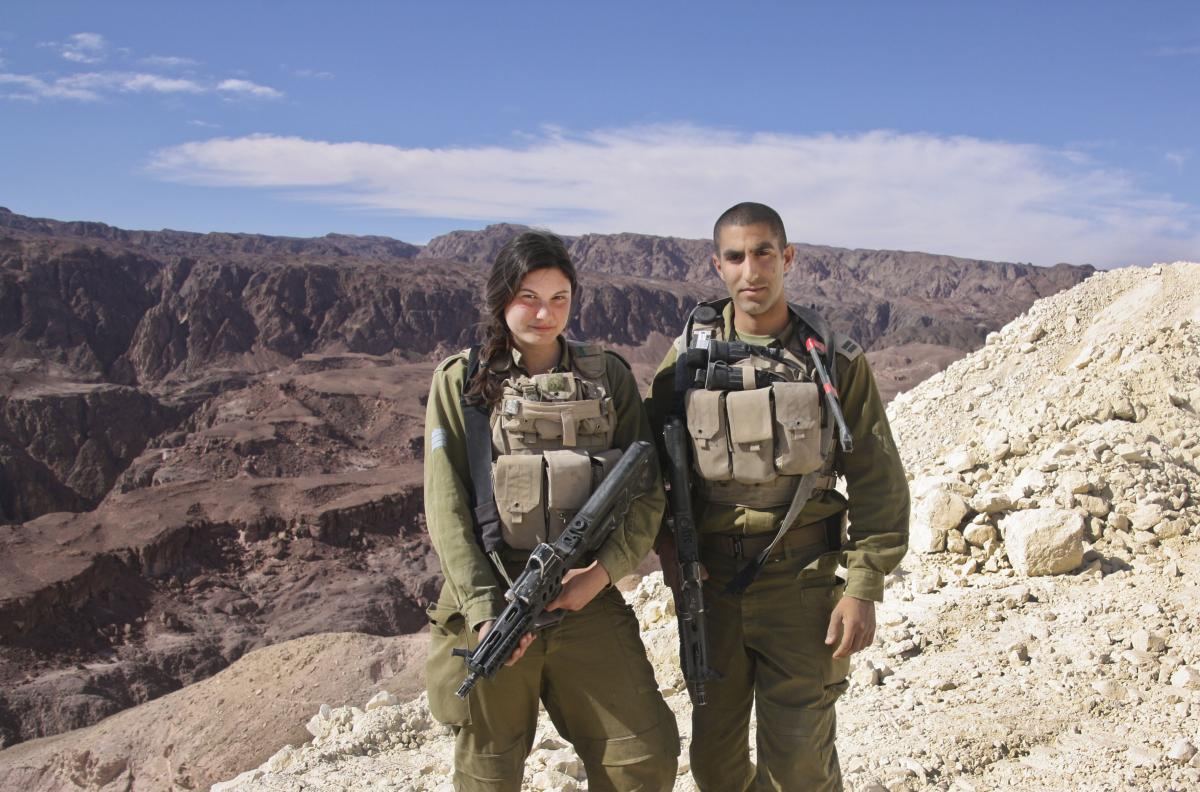 Sgt. Leora Prince (left) said switching to the Caracal battalion and taking on a more hands-on combat position was the best decision she'd ever made. She is shown here with her commanding officer, Capt. Yaron Eyal, near Eilat, along Israel's border with E