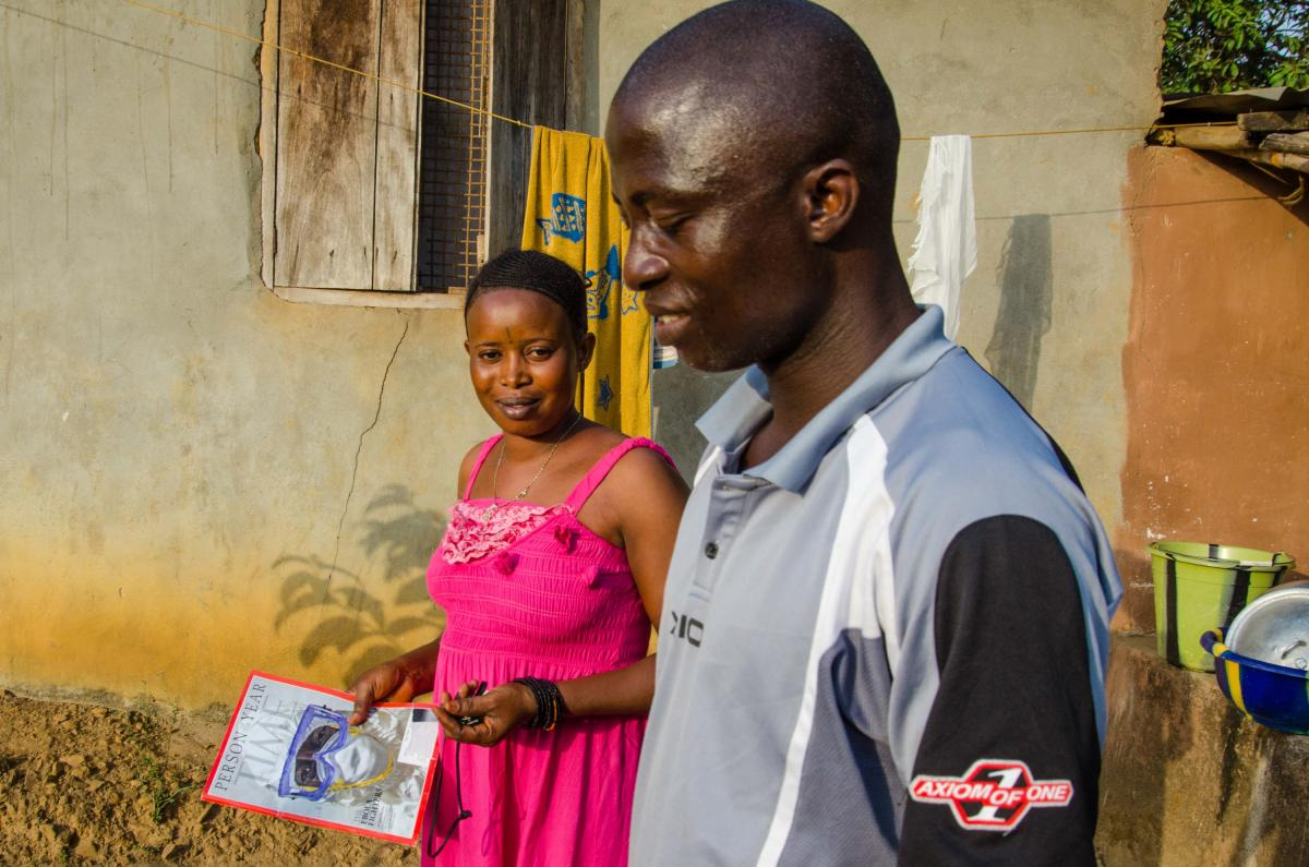 Nurse Issa French with his wife Anita, who's holding a copy of Time magazine's issue devoted to front-line workers. He's earned that title, treating more than 420 Ebola patients.