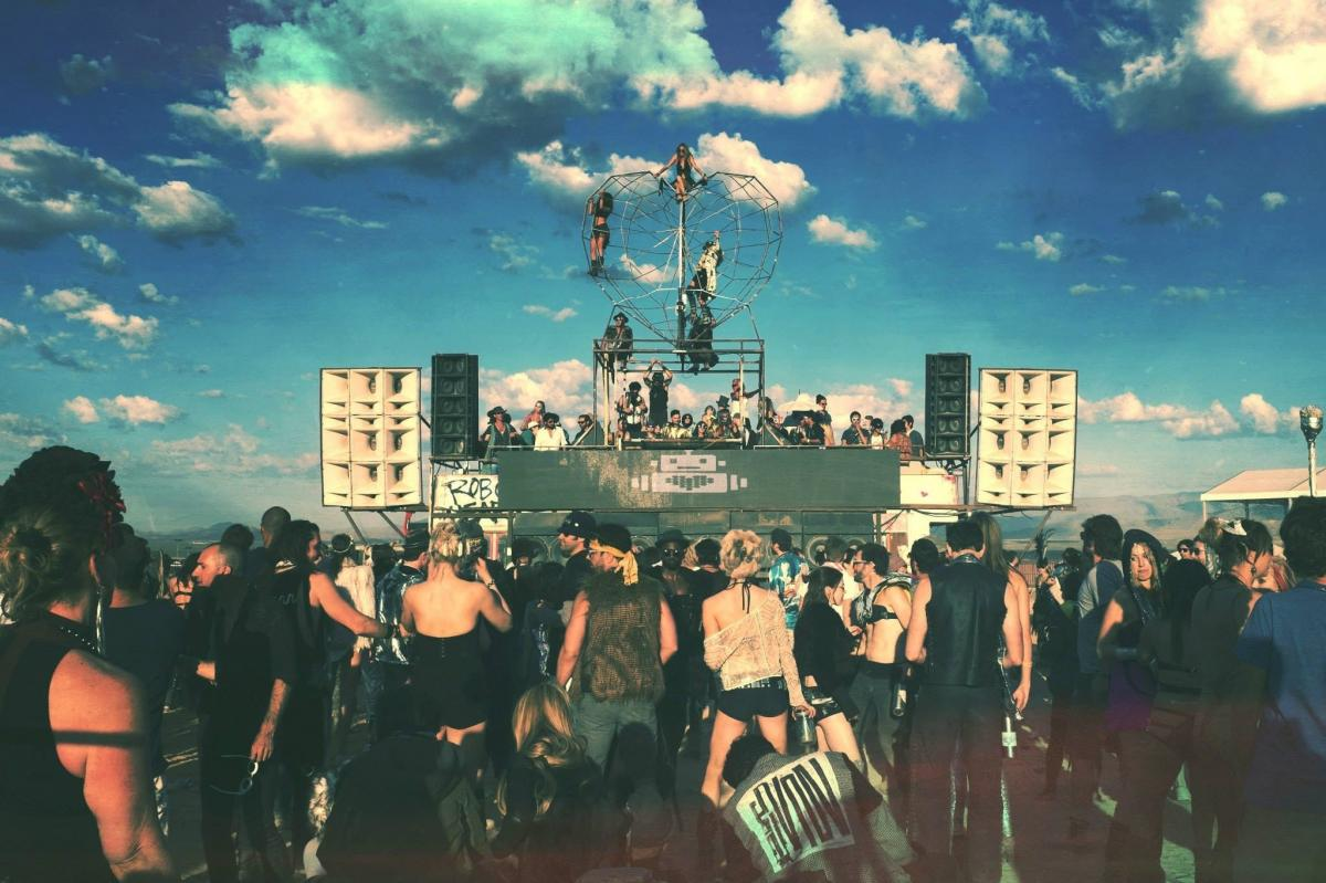 Revelers take in the Robot Heart art-car sound system at the 2014 Burning Man festival.
