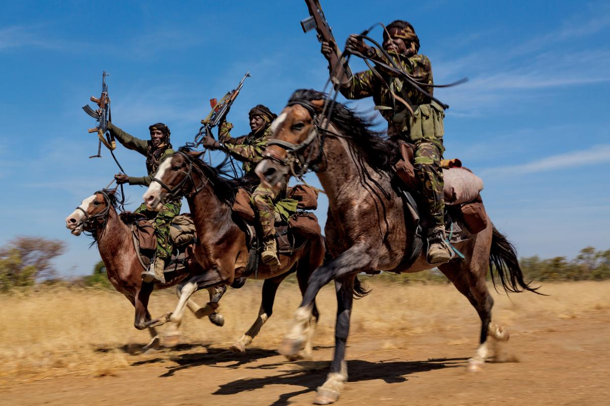 Rangers practice their riding skills at Zakouma National Park in Chad. The park has four mounted ranger teams because horses are the only way to effectively patrol during the wet season, when the elephants head to drier land outside the park.