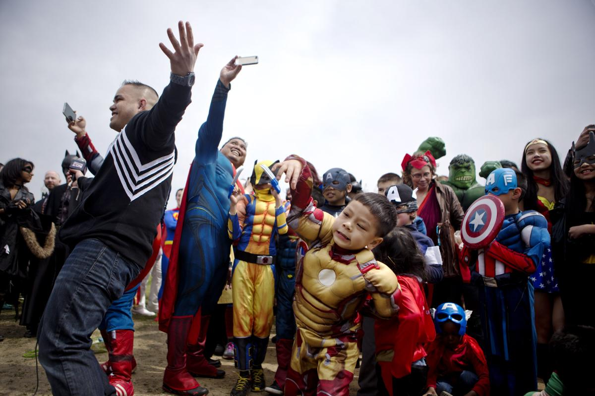 Hundreds of people arrive on the National Mall Friday to try to set a world record for the largest group dressed as comic book characters gathered in one location. The event was organized by Awesome Con 2014, a comic book convention that will take place i