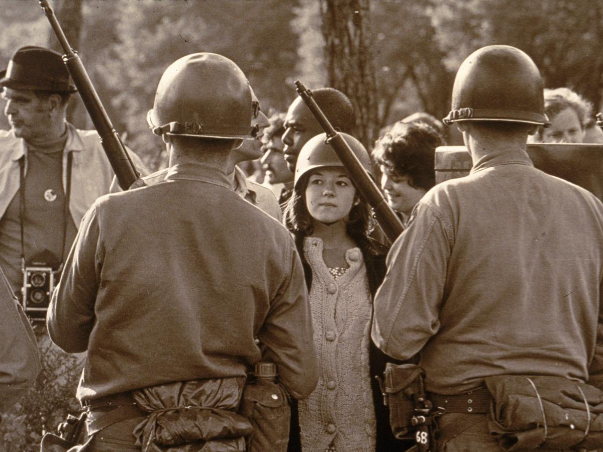 A young female protester faces down armed police officers at an anti-Vietnam War demonstration outside the 1968 Democratic National Convention in Chicago.