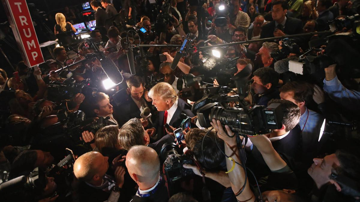 Donald Trump talks to reporters after Thursday's debate.