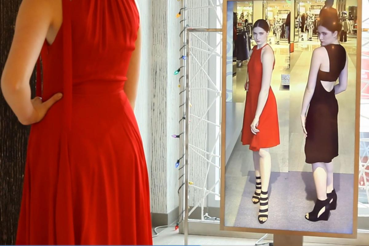 "Neiman Marcus is testing a digital ""Memory Mirror"" that lets shoppers see how an outfit looks in back as well as displaying items they've tried on side by side."