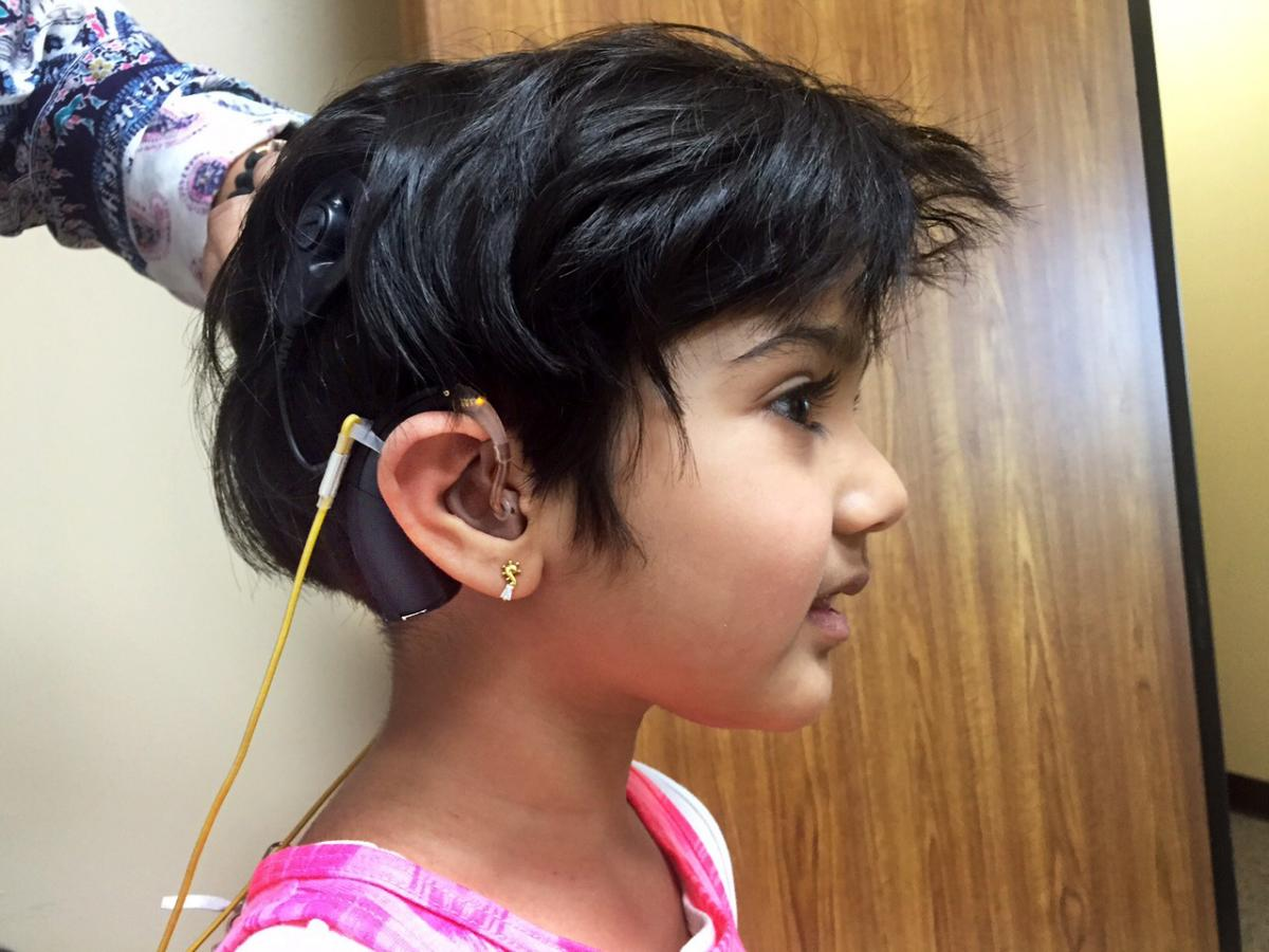 Jiya Bavishi's auditory brainstem implant is helping her hear some sounds for the first time.