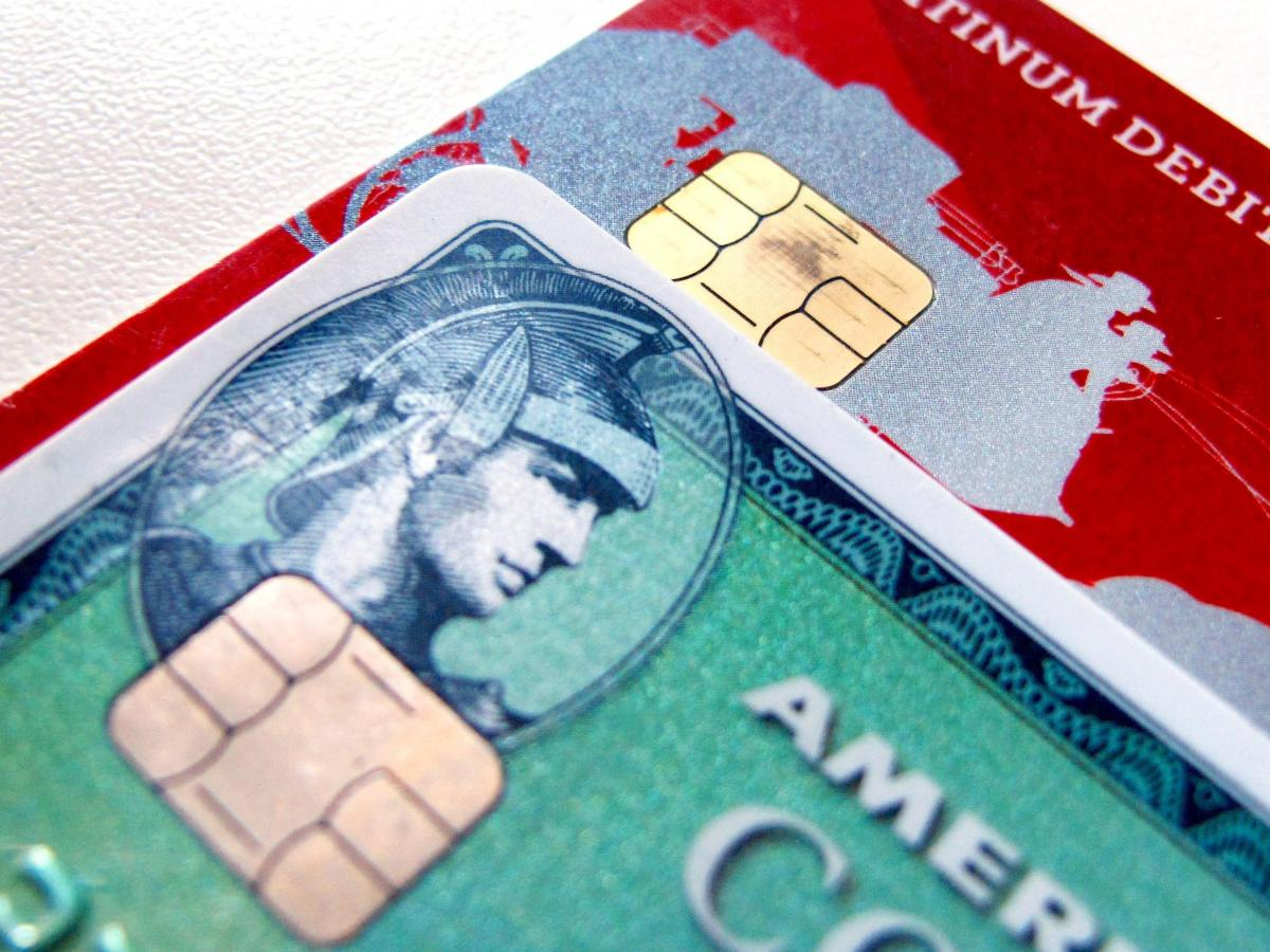 Computer chips are seen on newly-issued credit cards. In an effort to reduce counterfeiting and credit card fraud, more than 200 million payment cards have been issued with embedded computer chips in the U.S. ahead of an Oct. 1 deadline, according to the