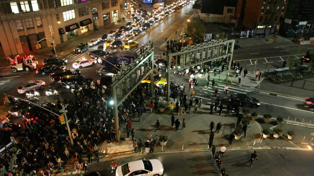 Demonstrators snarl traffic as they try to block an entrance to the Holland Tunnel during a solidarity protest Wednesday in New York City.