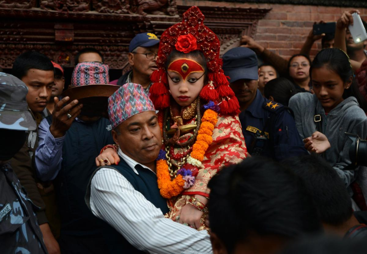 Nepal's Living Goddess, the Kumari Devi, 9, observes a chariot festival in Kathmandu on March 29. The goddess is worshipped by both Hindus and Buddhists. She's selected as a young child and lives an isolated and secretive existence and is rarely seen in p