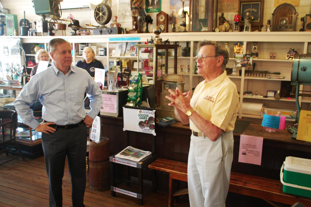 Lindsey Graham (left) and Bob Schroeder at Robie's Country Store in Hooksett, N.H.