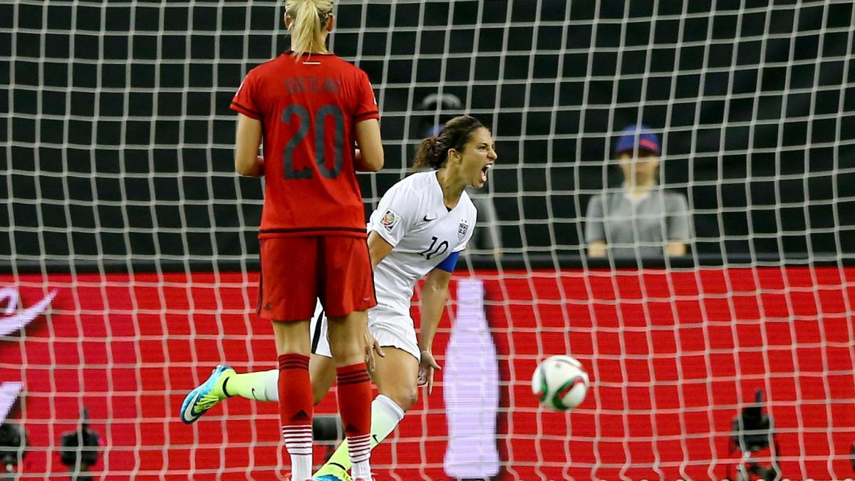 Carli Lloyd of the U.S. (in white) celebrates after scoring on a penalty kick Tuesday night in the Americans' 2-0 World Cup semifinal victory against Germany.